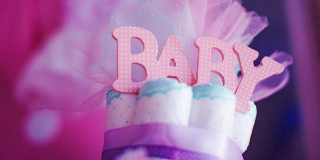 """Torta di pannolini: come realizzarla per un """"dolce"""" baby shower"""